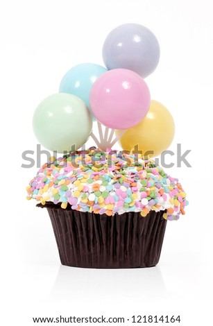 Happy Birthday muffin cupcake with colored plastic balloons - stock photo