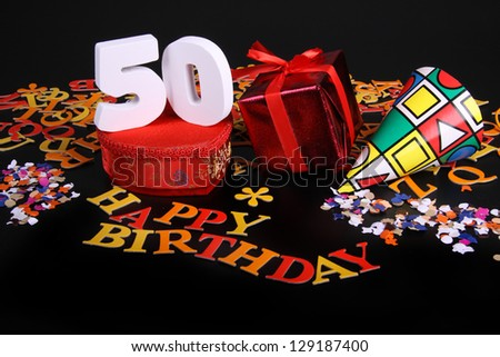 Happy birthday on a black background  and a red heart  and white characters and confetti - stock photo