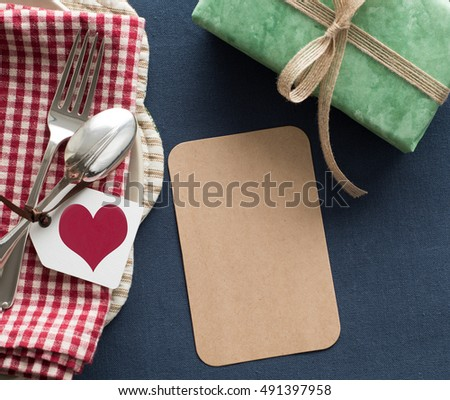 Happy Birthday or Valentine Day or Fathers Day Place setting with Blank Cards for your words, text or copy. There's a red heart tag and a green present in a casual still life style in Americana tones