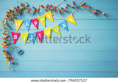 Happy birthday party background with text and colorful tools, top view. Happy birthday greeting card