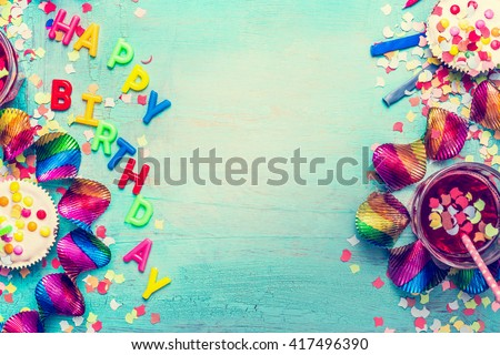 Happy birthday party background with text, drinks, cupcake and colorful tools, top view. Happy birthday greeting card - stock photo