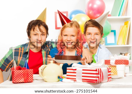 Happy birthday party with cake and presents - stock photo