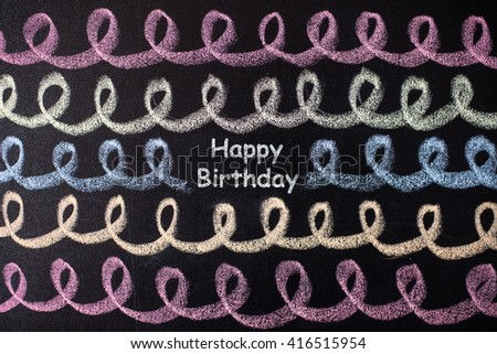 happy birthday title drawn with chalk on the blackboard. Different colors and festive look. - stock photo