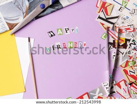 Happy bithday - ransom note style on violet - stock photo