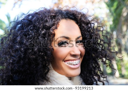 Happy black girl with braces - stock photo