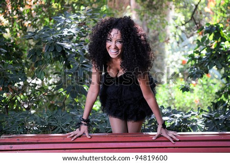 Happy black girl with braces in the park - stock photo
