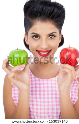 Happy black hair woman holding apples on white background - stock photo
