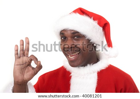 happy black santa claus showing an OK sign - stock photo