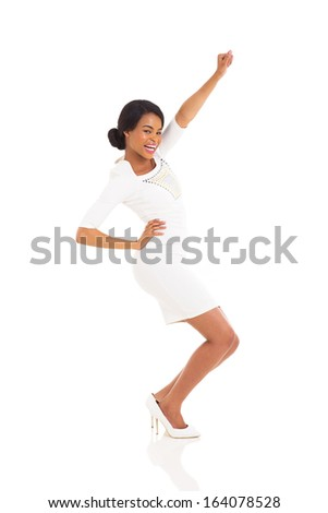 happy black woman dancing on white background - stock photo