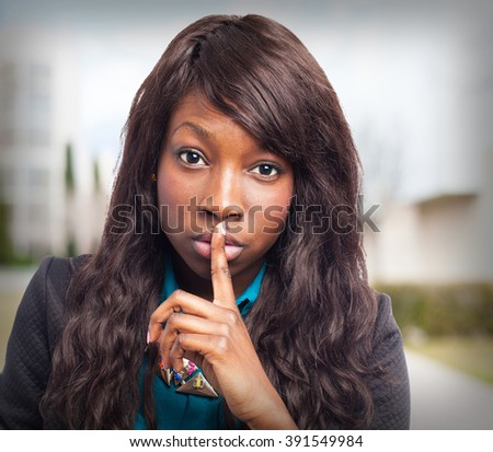 happy black-woman doing silence sign - stock photo