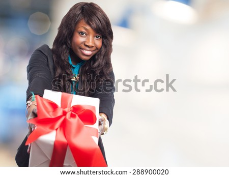 happy black woman holding a gift - stock photo