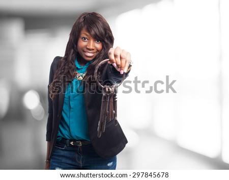 happy black woman holding keys - stock photo