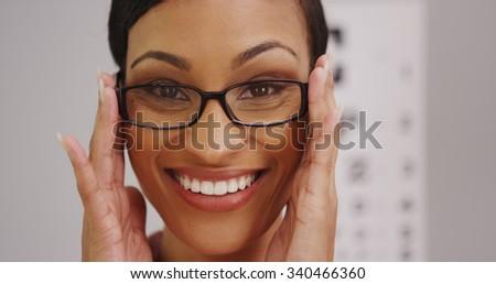 Happy black woman wearing eyeglasses - stock photo