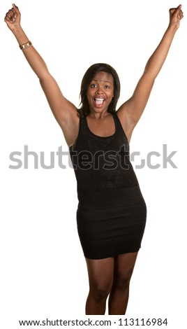 Happy Black woman with arms in the air over white background - stock photo