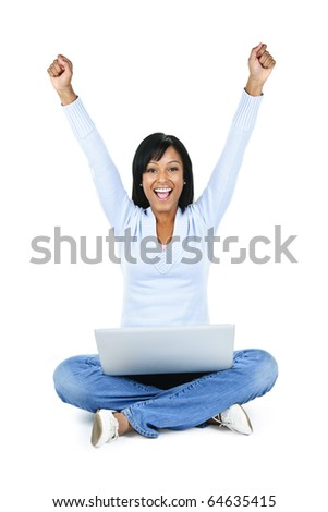 Happy black woman with arms raised and computer isolated on white background