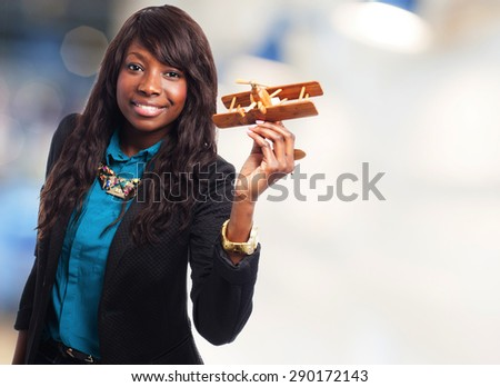 happy black woman with biplane