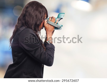 happy black woman with camera