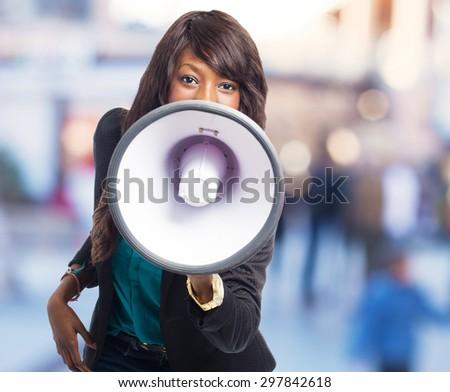 happy black woman with megaphone - stock photo