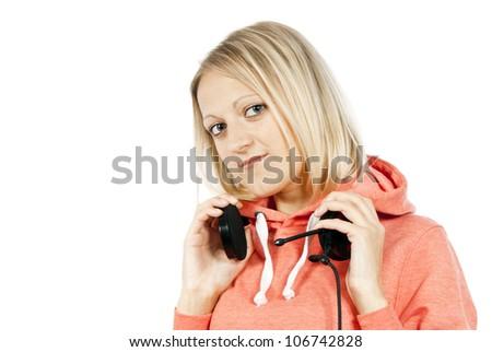 happy blond girl holding headphones isolated - stock photo
