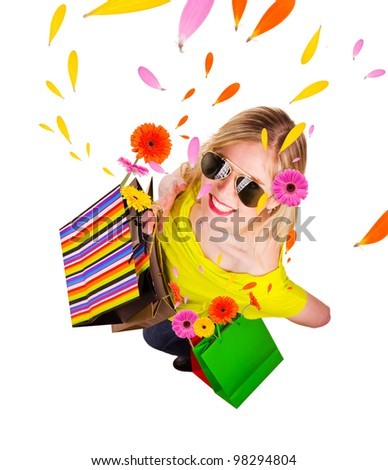 Happy blond girl with shopping bags in spring concept. Isolated on white background - stock photo