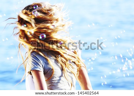 happy blond hair woman sea on background - stock photo