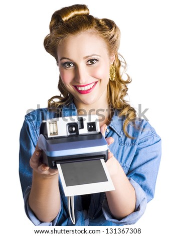 Happy blond woman holding a instant camera in a happy snap concept - stock photo