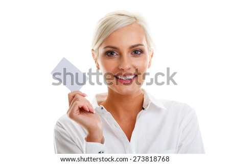 Happy blond woman showing blank credit card over white background - stock photo