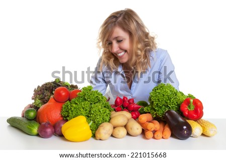 Happy blond woman with fresh vegetables