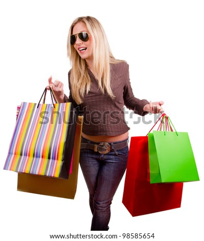 Happy blond woman with shopping bags, isolated on white background - stock photo