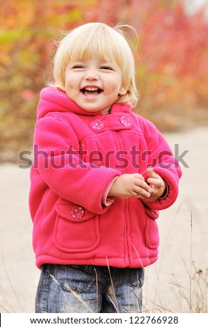 happy blonde baby with dimple cheeks - stock photo