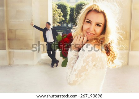 happy blonde bride posing looking in the camera - stock photo