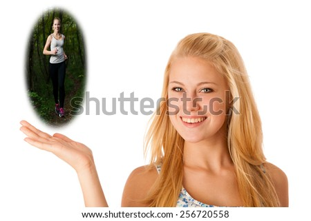 Happy blonde caucasian woman holds hand in copyspace isolated over white with a bauble image of a runner outdoors running in forest - stock photo