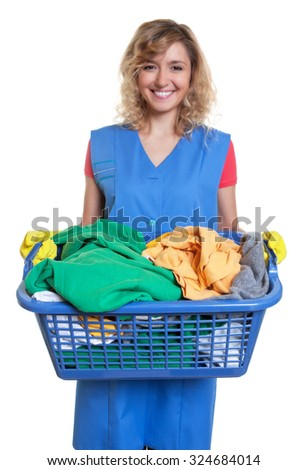 Happy blonde housewife with dirty clothes - stock photo