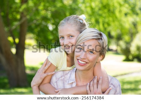 Happy blonde with her daughter on a sunny day