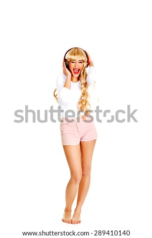 Happy blonde woman dancing and listening to the music. - stock photo