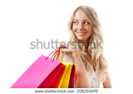 happy blonde woman holding shopping bags over white, copy space for text - stock photo