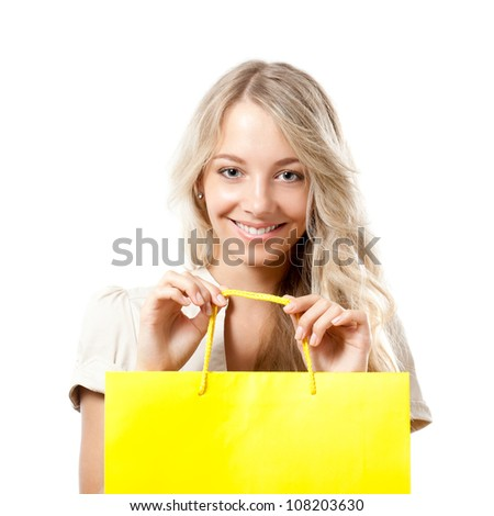 happy blonde woman holding yellow shopping bag - stock photo