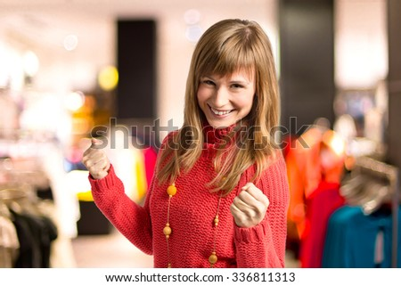 Happy blonde woman over unfocused background