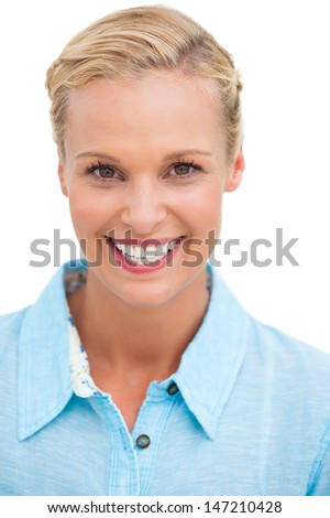 Happy blonde woman smiling at camera on white background - stock photo
