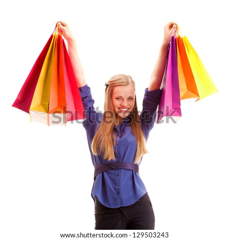 happy blonde woman with shopping bags over white