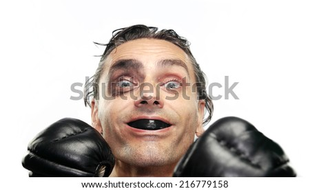 happy boxer man shows his gum shield - stock photo
