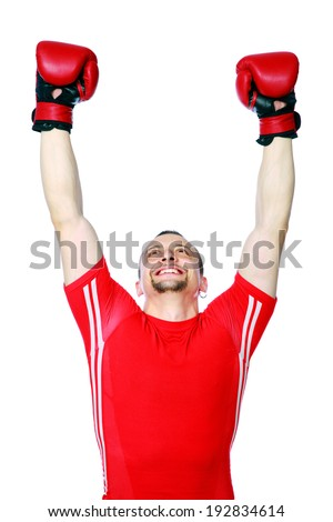 Happy boxer man winner raising arms over white background