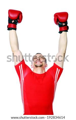 Happy boxer man winner raising arms over white background - stock photo