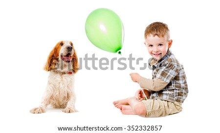 Happy boy and dog breed Russian Spaniel playing together, isolated on white background