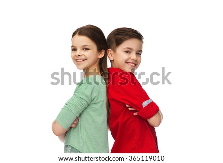 happy boy and girl standing together - stock photo