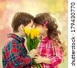 Happy boy and girl with bouquet of flowers. Spring, Mothers day, family holiday - stock photo