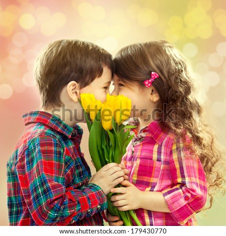 Happy boy and girl with bouquet of flowers. Spring, Mothers day, family holiday