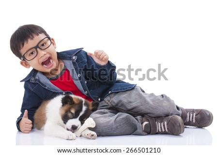 Happy boy and Thai Bangkaew puppy on a white background - stock photo