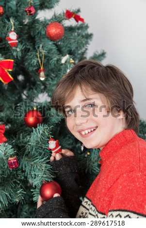 Happy boy beside the christmas tree