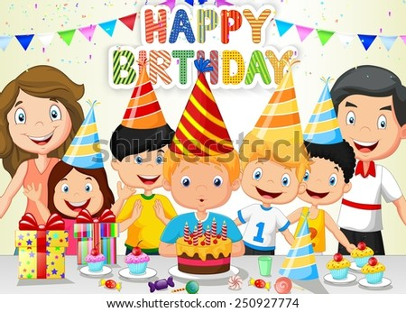 Happy boy blowing birthday candles with his family and friends - stock photo